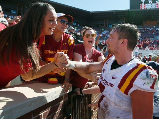 Iowa State's Joel Lanning (7) celebrates with fans