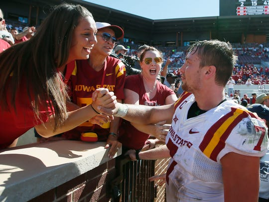 Iowa State's Joel Lanning (7) celebrates with fans