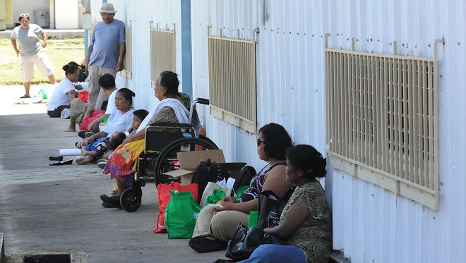"""People gather during the annual """"Hope for the Homeless: Passport to Services"""" an outreach event for Guam's Homeless individuals and families, hosted by the Guam Homeless Coalition in coordination with the Guam Urban and Housing Renewal Authority on May 11."""