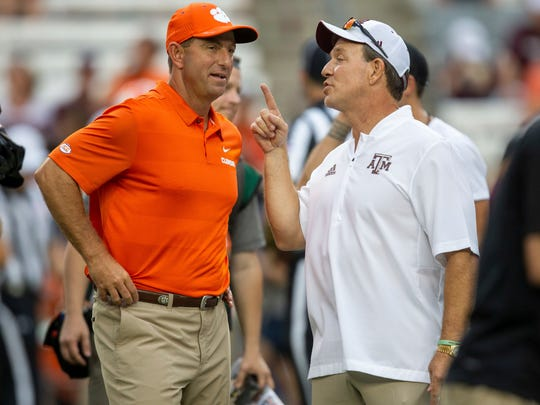 FILE - In this Sept. 8, 2018, file photo, Clemson head coach Dabo Swinney, left, and Texas A&M head coach Jimbo Fisher talk before the start of an NCAA college football game, in College Station, Texas. An example of the SEC's depth is No. 22 Texas A&M, which plays at No. 1 Alabama this week. The Aggies' only loss was to No. 3 Clemson, 28-26. (AP Photo/Sam Craft, File)