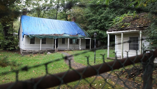 The Miller House in North White Plains sits under a tarp and behind locked gates Thursday as Westchester County decides its fate. The building is on the National Register of Historic Places as one of George Washington's headquarters.