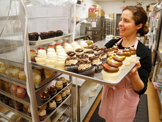 Owner Emily A. Goertemoeller places a large tray of