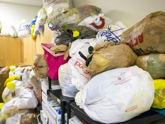 Thousands of plastic bags fill a storage room at Newark Charter High School. They will be woven into mats for the homeless.