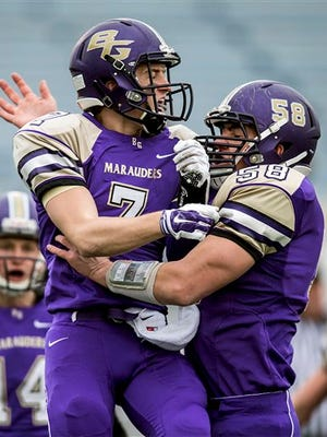 Bishop Guilfoyle's Josh Trybus celebrates his first quarter touchdown against Farrell, during a PIAA A Championship football game Friday at Hersheypark Stadium