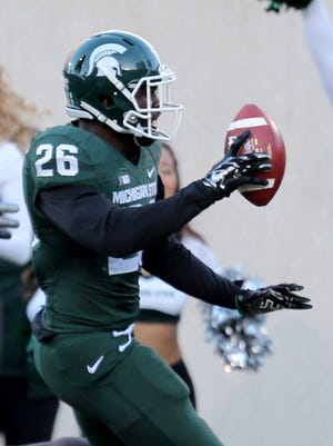 Michigan State's RJ Williamson intercepted a pass by Michigan's Devin Gardner and ran it back for a touchdown during third quarter action on Saturday, October 25, 2014.