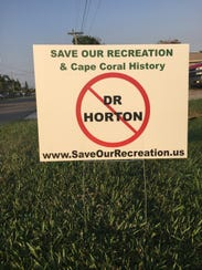 Save Our Recreation previously distributed signs to protest a possible development of the Cape Coral Golf Course.