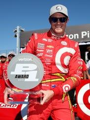 Scott Dixon with his Verizon IndyCar pole award after