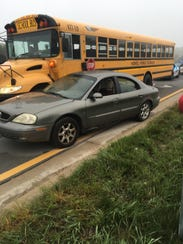 A school bus and a car sideswiped one another in the