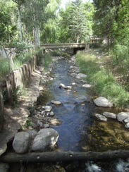 Sturdy bridges cross the Rio Ruidoso along Ruidoso