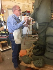 Sculptor Garland Weeks finesses some detail into the