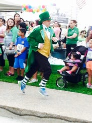Shamrock Shuffle volunteer leprechaun John Holt makes