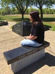 Ciaran Foran Madden contemplates a monument that bears