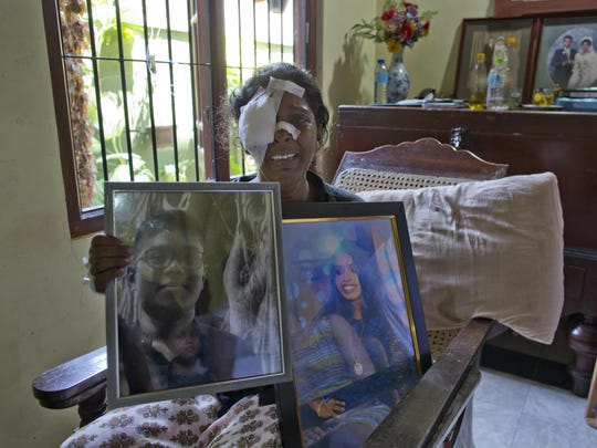 Anusha Kumari holds portraits of her daughter Sajini Venura Dulakshi and son Vimukthi Tharidu Appuhami, both victims of Easter Sunday's bomb blast in Negombo, Sri Lanka, Wednesday, April 24, 2019. Kumari, 43, was left childless and a widow when suicide bombers launched a coordinated attack on churches and luxury hotels in and just outside Sri Lanka's capital, Colombo.