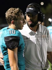 Gulf Coast High School assistant coach Tom Scalise talks to a player on the sideline during a game in 2017. Scalise was named Gulf Coast's new head coach on Sunday.
