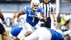 Memphis running back Tony Pollard (middle) looks for