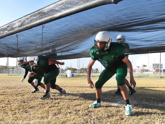 King football players work on a drill earlier this season on the high school's practice field. If a bond is passed on Nov. 8, the main practice fields at each CCISD high school will have turf installed.