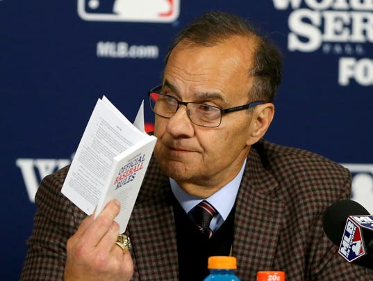 102613-joe-torre-rule-book-obstruction-gallery