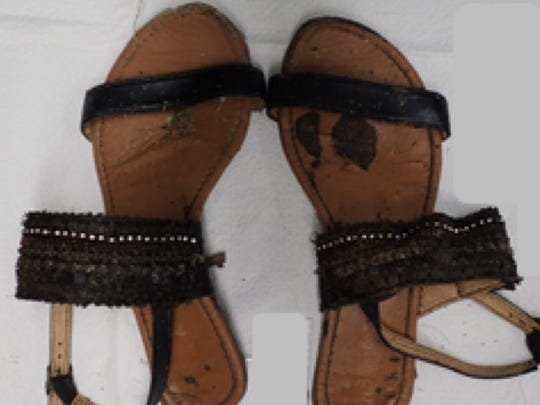 Authorities are attempting to identify a woman found dead in Colerain Township this month. The Hamilton County Coroner's Office said she was wearing these shoes.