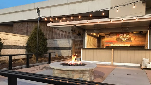 Customers will find a fire pit and bar on the warm-weather