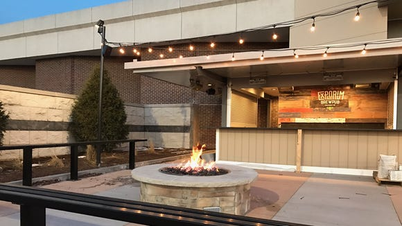 Customers will find a fire pit and bar on the warm-weather patio at the new Explorium Brewpub at Southridge Mall.