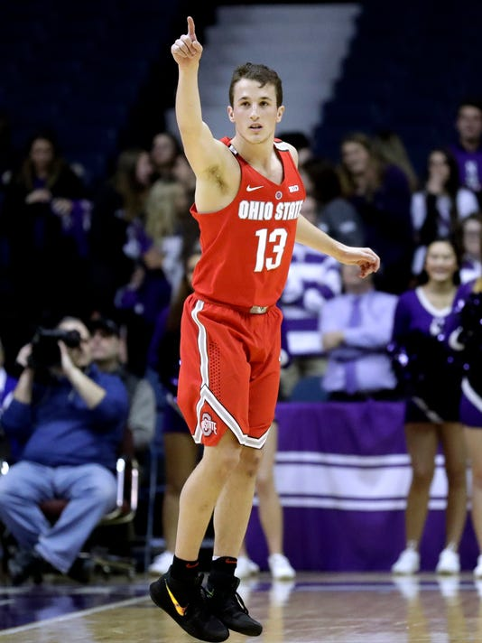 Ohio State guard Andrew Dakich points after making a three point shot against Northwestern during the first half of an NCAA college basketball game Wednesday, Jan. 17, 2018, in Rosemont, Ill. (AP Photo/Nam Y. Huh)