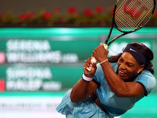 American Serena Williams returns the ball to defending champion Simona Halep of Romania on Wednesday, March 16, 2016 during the BNP Paribas Open in Indian Wells, Calif. Williams won in straight sets, 6-4, 6-3.