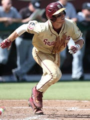 Florida State leadoff hitter Taylor Walls gets a hit