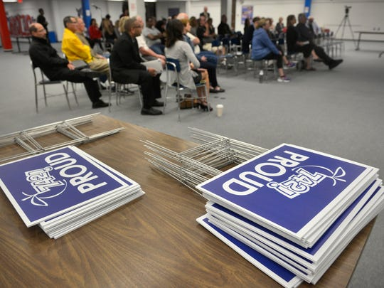 Lawn signs expressing pride and support for District 742 sit on a table during a community referendum presentation Monday, Oct. 3, at Apollo High School.