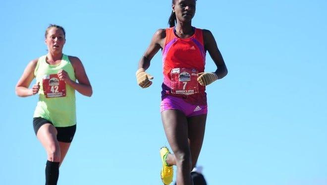 Des Moines runner Obsie Birru (front).