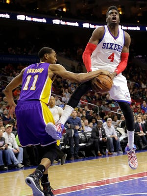 Los Angeles Lakers forward Wesley Johnson (left) blocks a shot by 76ers center Nerlens Noel during the second half on Monday in Philadelphia.