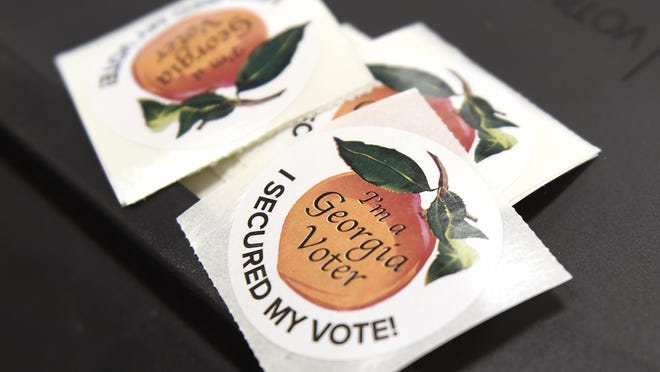 Georgia voter stickers before being given away to voters after they cast their ballots at Christ Church, Presbyterian in Evans, Ga., Tuesday morning November 3, 2020.