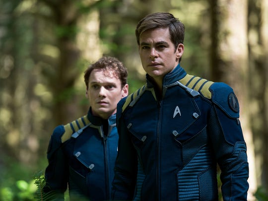 """Anton Yelchin (left) and  Chris Pine star in """"Star Trek Beyond."""" The movie carries a dedication to Yelchin, who died June 19, 2016, after shooting was completed."""