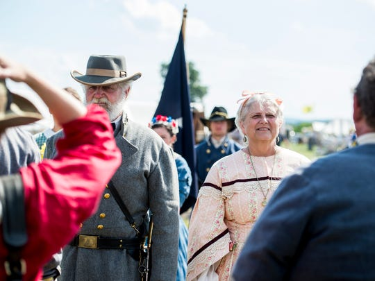 Earl and Donna Weaver, of South Annville, greet people following their wedding vow renewal ceremony at the Battle of Gettysburg re-enactment site in Freedom Township on July 2, 2017. The Weavers, who are celebrating 50 years of marriage, portrayed General Robert E. Lee and Mary Anna Custis Lee.