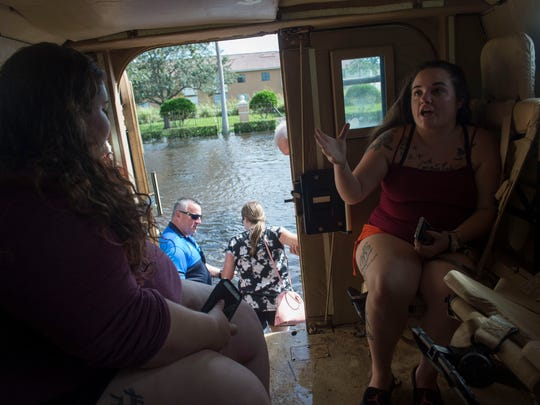 Casey Schaffer (right) and Kristen Schaffer describe their experience seeing alligators in the flooded Sabal Chase apartment complex during Hurricane Irma, as they get shuttled to the nearby Walmart parking lot in Fort Pierce police's Mine-Resistant Ambush Protected military vehicle on Monday, Sept. 11, 2017, in Fort Pierce.