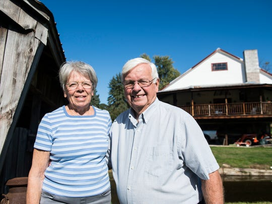 Don and Marilyn Ruth pose for a photo in front of their barn in Jackson Township on Wednesday, Oct. 25, 2017. The original structure dates back to 1777, and Don and Marilyn purchased it in 1959.
