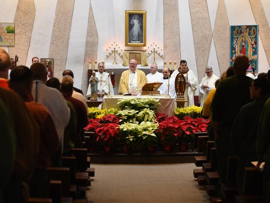 Cardinal Timothy Dolan leads mass for the 50th anniversary