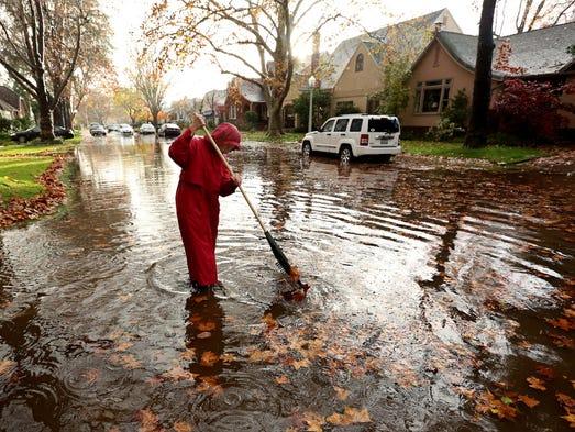 Marilyn Van Schenk stands in knee-deep water as she