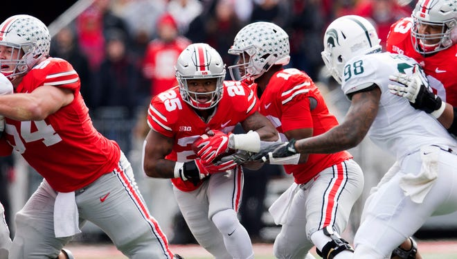 Nov 11, 2017; Columbus, OH, USA; Ohio State running back Mike Weber takes a handoff from quarterback J.T. Barrett and runs for a 47-yard touchdown against Michigan State in the first quarter at Ohio Stadium.