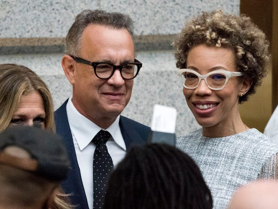 Tom Hanks and artis Amy Sherald, right, pose for a