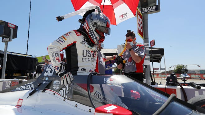 Marco Andretti climbs into the cockpit of his car during practice for the IndyCar race at Texas Motor Speedway on Saturday in Fort Worth, Texas.