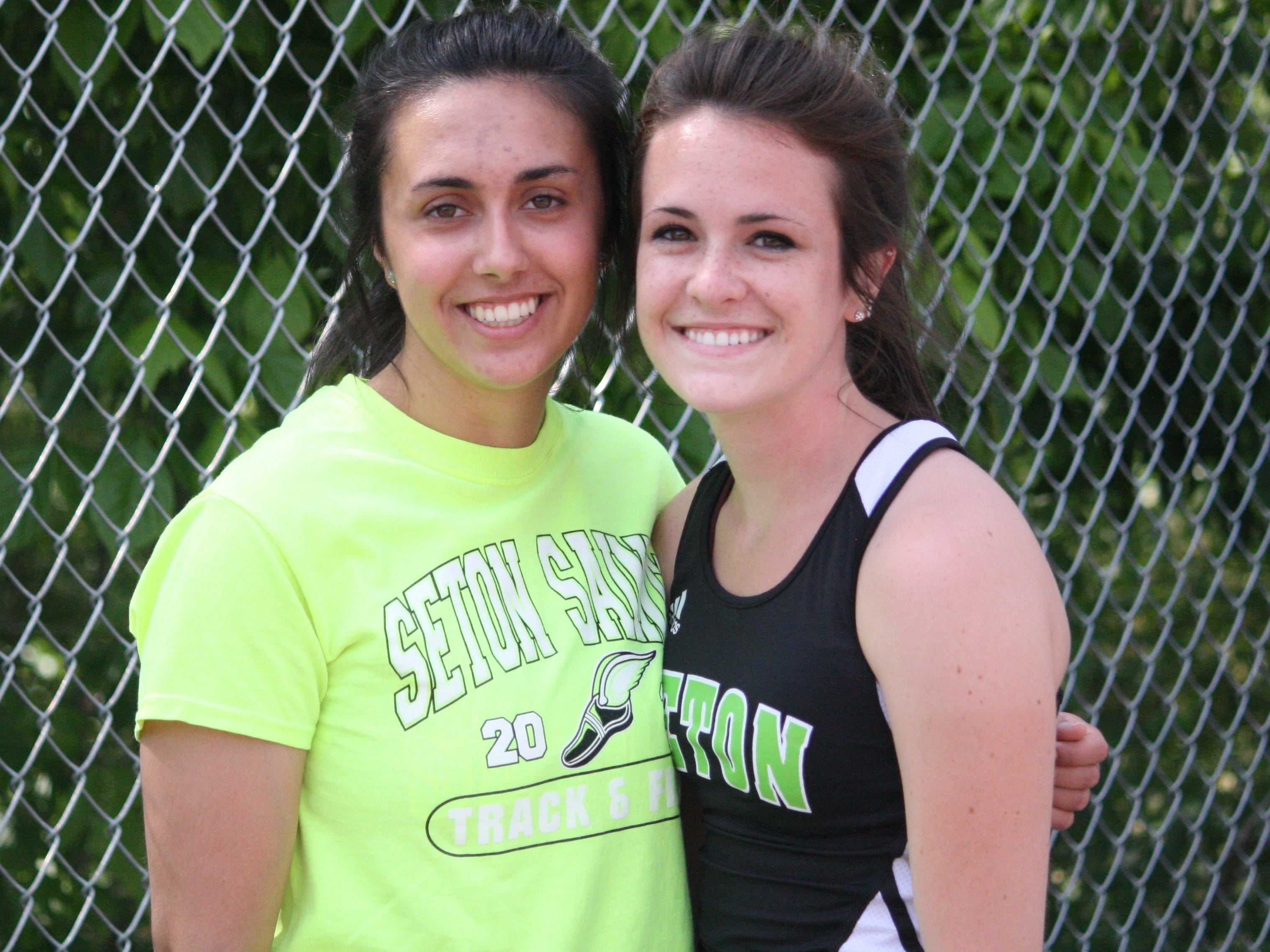 Seton High School seniors Katie Jacobs, left, and Lauren Lipps run at the GGCL track and field championships May 15 at La Salle.