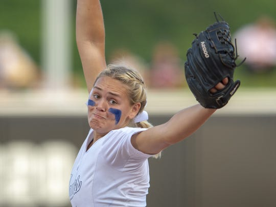 Decatur Central senior Karli Ricketts (5) delivers a pitch during the 34th Annual IHSAA Softball State Finals class 4A game,