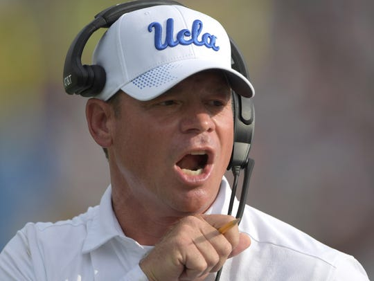 UCLA coach Jim Mora barks instructions during his team's