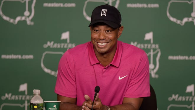 Four-time Masters champion Tiger Woods speaks with the media before the Masters at Augusta National Golf Club on April 7.