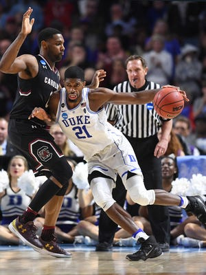 Duke forward Amile Jefferson (21) tries to drive past South Carolina guard Sindarius Thornwell (0) during the 2nd round of the NCAA Tournament at Bon Secours Wellness Arena in downtown Greenville on Sunday, March 19, 2017.