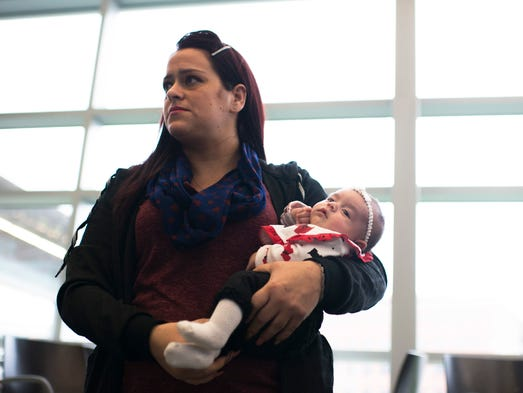 Camden resident Dolores Peterson holds her 5-week-old