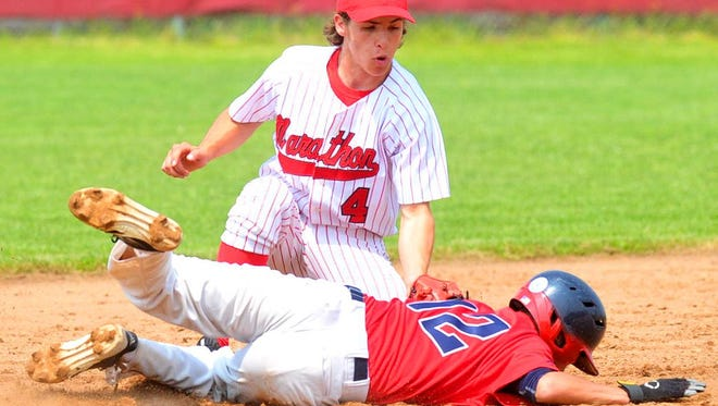 Marathon's Noah Dirks tags out Pacelli's Brett Barton as he attempts to slide into second base during Tuesday's WIAA Division 3 sectional semifinal baseball game at Marathon High School. The Raiders beat Pacelli, then later went on to win over Coleman to earn a trip to state.