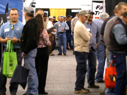 Four Corners Oil and Gas Conference goers mingle, Thursday,