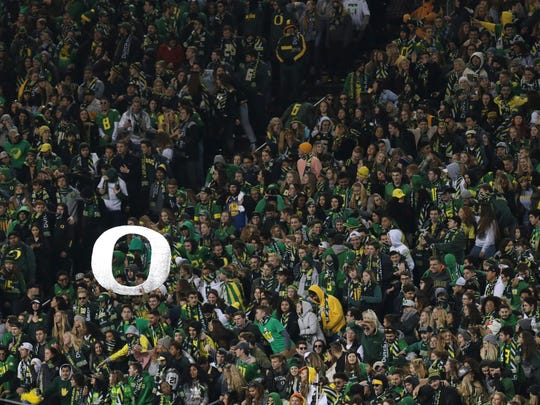 Oregon Ducks fans cheer in the second quarter against