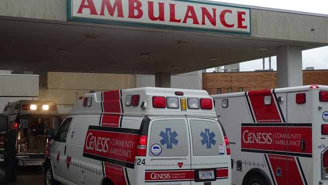 Ambulances line up near Good Samaritan's emergency department Saturday morning awaiting the next group of patients to be transported to the new Genesis Hospital.